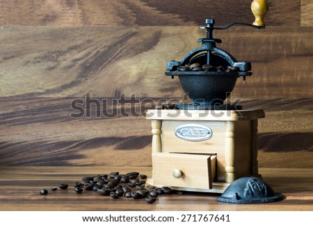 Coffee grinder with coffee beans, isolated