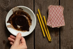 coffee grounds on a saucer for fortune telling cards and candles on the table, fortune telling on coffee grounds