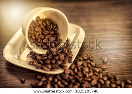 Coffee. Hot coffee. Coffee bean. Wooden table. Blurred background #1025183740