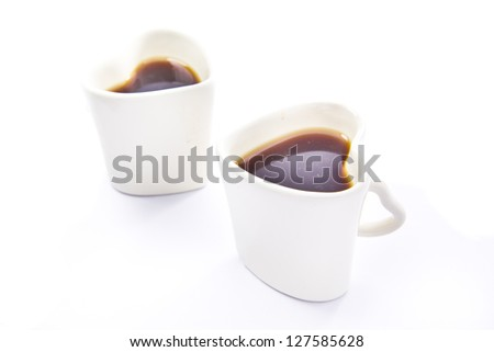 Coffee in a couple white love cup for valentines day