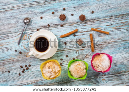 Coffee in a Cup and beans on a blue background