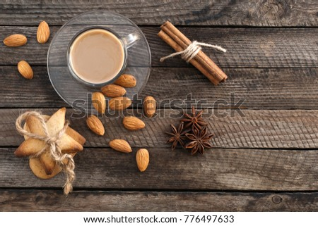 Coffee in a cup, biscuits and spices on a wooden surface #776497633