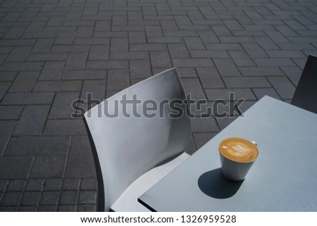 Coffee in a street cafe, street cafe with cup, Empty coffee terrace with tables and chairs in street cafe, latte art, Drinking coffee in the street cafe, Fashionable white coffee set and cutlery #1326959528