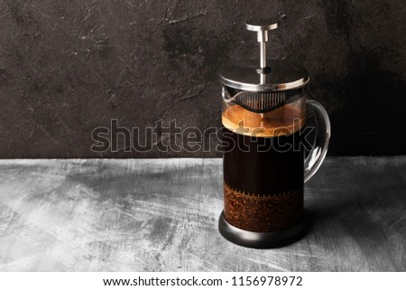 Coffee in french press on dark background. Copy space. Food background