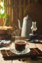 Coffee is a drink made from coffee beans that have been roasted and ground into a powder and can be drunk at any time for relaxation or activity