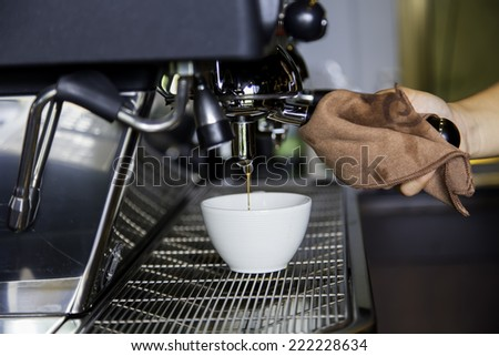 Coffee is pouring a glass of coffee machines.