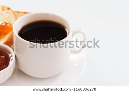 Coffee, jam and homemade bread. Traditional breakfast on a light background. Copy space. #1160306278
