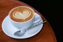 coffee latte art with heart shape  in coffee shop cafe