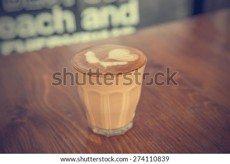coffee latte cup on a wood table -vintage effect style pictures #274110839