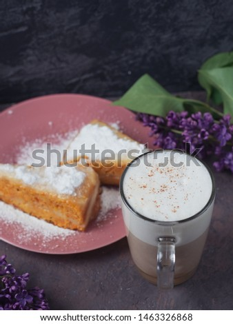 Coffee latte in a glass glass glass glass with a piece of cake cozy atmospheric background with flowers #1463326868