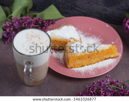Coffee latte in a glass glass glass glass with a piece of cake cozy atmospheric background with flowers #1463326877