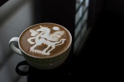 Coffee Latte on Glass table, Latte art Pegasus