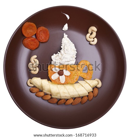 Coffee latte. Orange Cup of cottage cheese on a banana saucer - stock photo