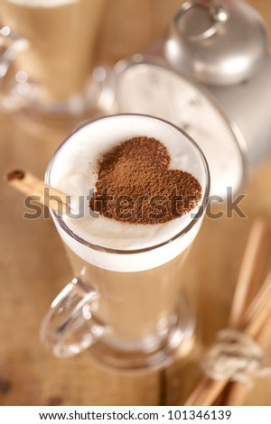 coffee latte with cinnamon sticks, focus on stiks end, , shallow dof