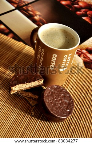 Coffee latte with cookies on a american biscotti mat and coffee themed collage