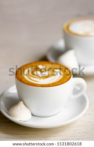 Coffee Latte (with latte art) in a cup on the wooden table #1531802618