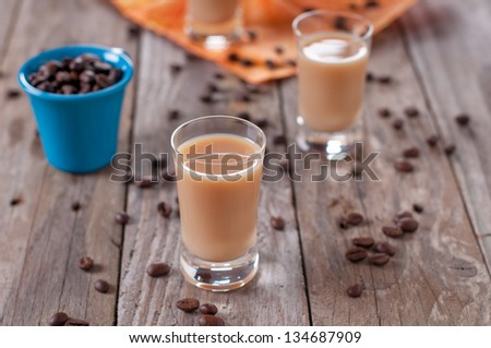 Coffee liqueur on the wooden table, selective focus