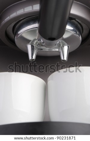 Coffee machine espresso. Two white cups and the equipment for coffee preparation. A close up