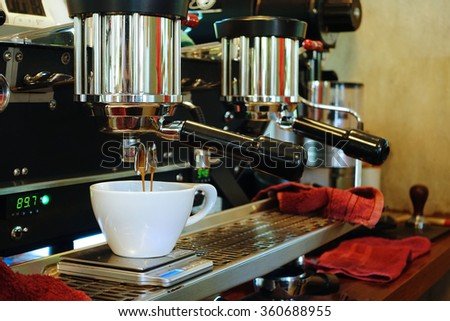 coffee machine preparing cup of coffee. #360688955