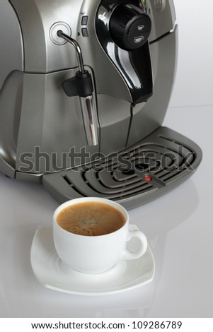 Coffee machine with a cup of coffee. - stock photo