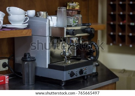 Coffee machine with cups behind in bar in fitness club #765665497