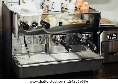 Coffee machine with cups on top #1242066586