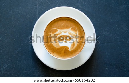 Coffee made with picture of raccoon wearing mask in froth