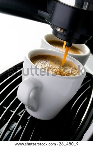 Coffee maker pouring hot espresso coffee in two cups. Take your break!