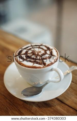 coffee mocha on the wood desk #374380303