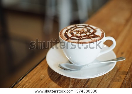 coffee mocha on the wood desk #374380330