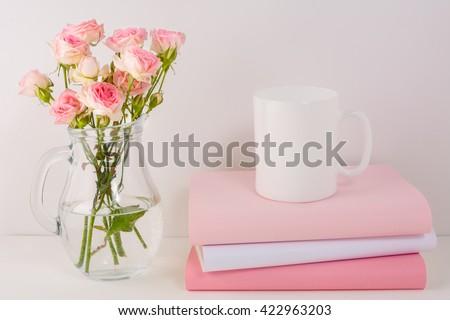 Coffee mug mockup with pink roses. White mug mockup. Blank mug.