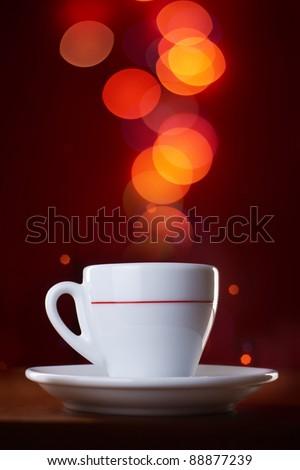 Coffee mug on abstract light background