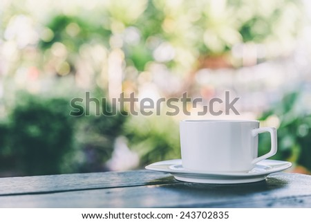 Coffee mug on wooden table outdoor background - Vintage effect style pictures