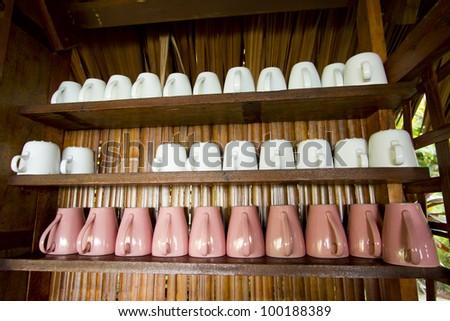 coffee mug shelf, pink and white coffee mug glass on shelf