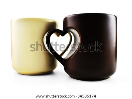 Coffee mugs with heart shape handles, on white background.