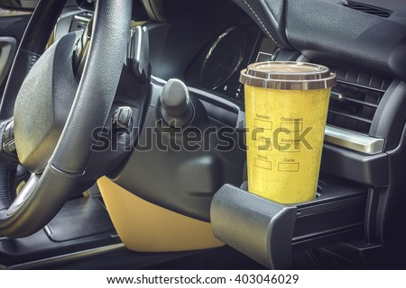 Coffee mugs yellow Placed on the vehicle console