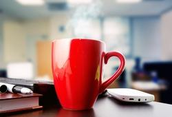 coffee on a black table showing break or breakfast in office