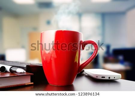coffee on a black table showing break or breakfast in office - stock photo
