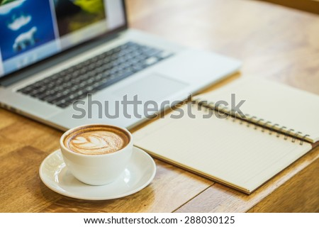 coffee on a table showing break or breakfast in coffee shop or office,late art