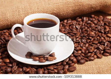 Coffee on burlap in beans with cinnamon and anise