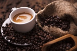 Coffee  on the coffee beans background