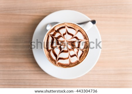 coffee on wood background #443304736