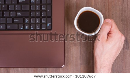 Coffee on wood floor with a laptop