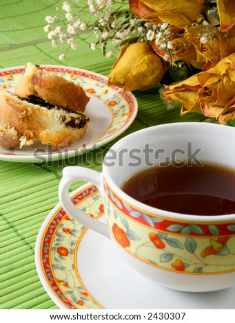 coffee or black tea with cake and dried flowers decoration