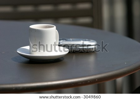 coffee or espresso and a cell phone outside - stock photo