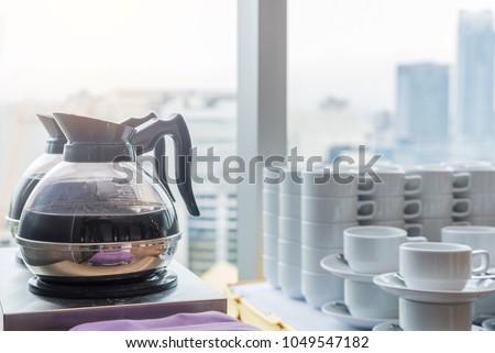 Coffee or tea in kettle boiler pot for conference break.