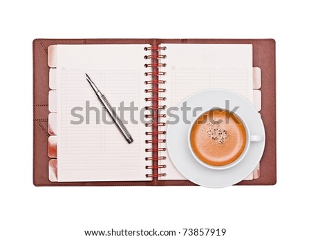 Coffee, pen and organizer on a white background