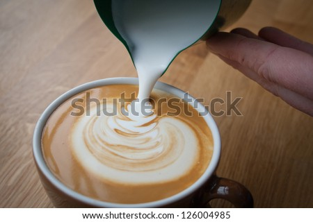 Coffee Pouring By A Barista, Uk.