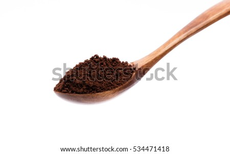 coffee powder on wood spoon isolated on white background