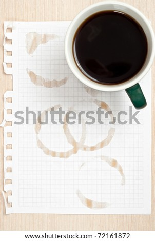 Coffee rings and cup of coffee stains on white paper background - stock photo